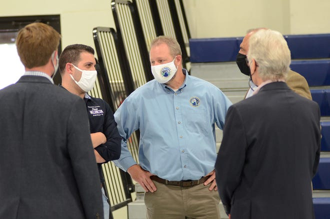 Ascension Parish President Clint Cointment, center, chats with District 6 council member Chase Melancon, Glenn Shaheen, and others March 16 during the open house event at Lowery Elementary School in Donaldsonville.