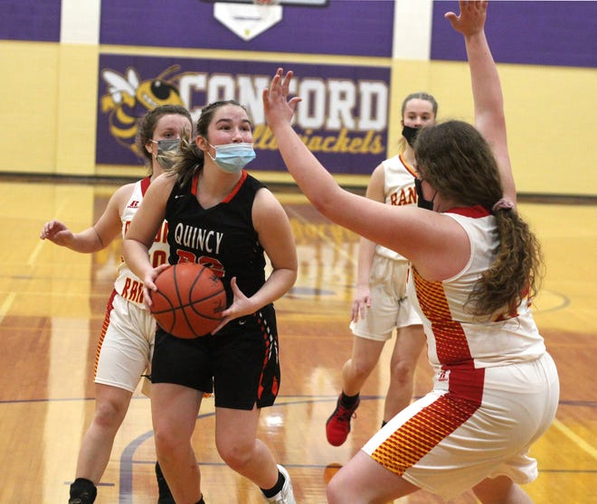Quincy's Samantha Hagaman weaves her way through the Reading defense on her way to a big second half bucket Monday night during District play
