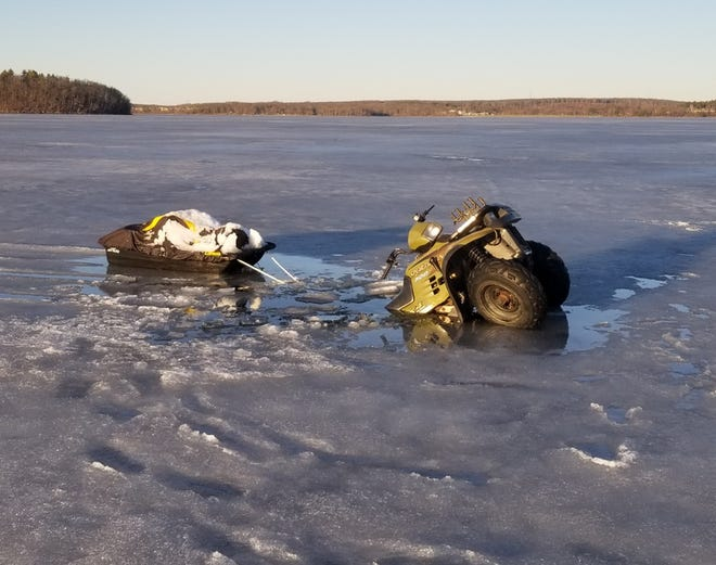 Tafton Dive & Rescue responded to this ATV partly fallen through the melting ice on Lake Wallenpaupack, March 12. The two people aboard the ATV made it to shore safely.