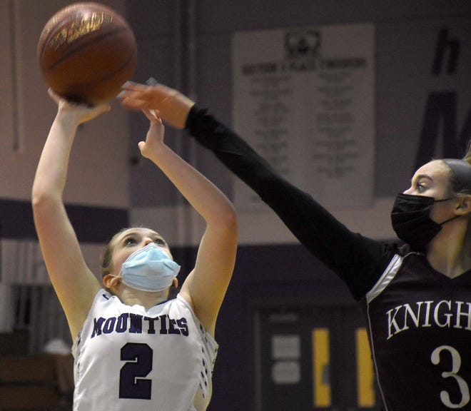 Little Falls Mountie Riley Dunn (2) shoots over the outstretched hand of Frankfort-Schuyler Maroon Knight Skye Simmons during the fourth quarter Monday, March 22, 2021, in Little Falls, New York