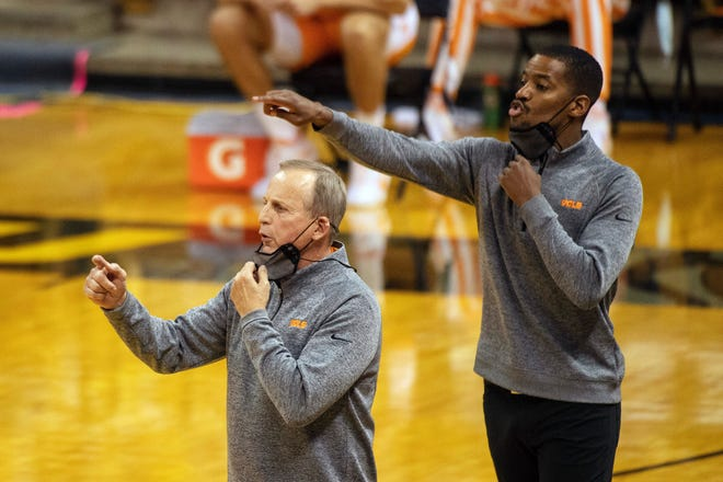 Former Mizzou and NBA player and college assistant Kim English, here positioning players with Tennessee head coach Rick Barnes in a game at Missouri this season, was hired to coach George Mason Tuesday, a week after the school fired Dave Paulsen.