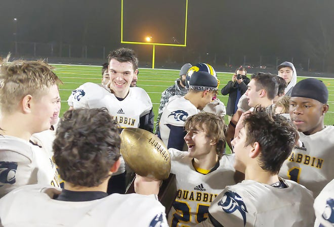 Quabbin's Noah Herzig holds the trophy after the Panthers' victory over Gardner High on Thanksgiving Eve of 2019. Herzig and Hector Johnson (1), far right, are two of 14 seniors who graduated from the 2019 team whom the Panthers are attempting to replace heading into the Fall II season.
