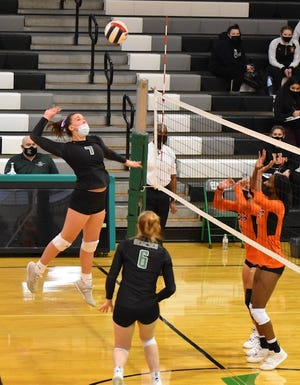 Junior Hannah Copeland in action at the GHS volleyball season opener against United Township in Geneseo.