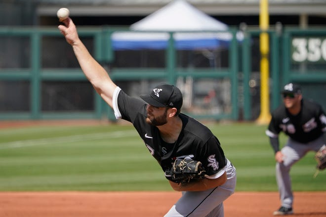 Chicago White Sox's Lucas Giolito pitches in the fourth inning of a spring training game against the Texas Rangers on Friday, March 12, 2021, in Surprise, Ariz.