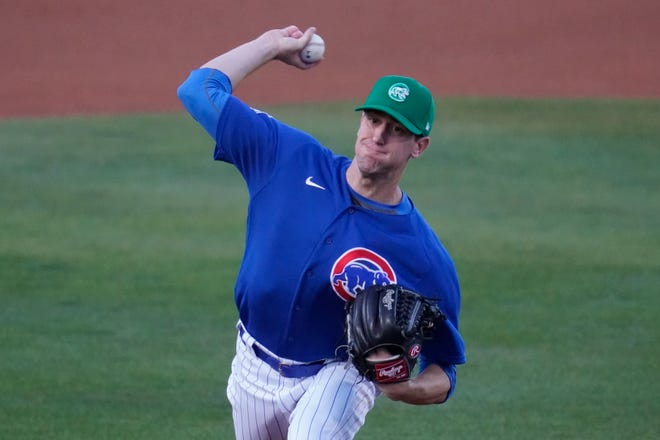 Chicago Cubs starting pitcher Kyle Hendricks (28) throws during the first inning of a spring training baseball game against the San Diego Padres on Wednesday, March 17, 2021, in Mesa, Ariz.