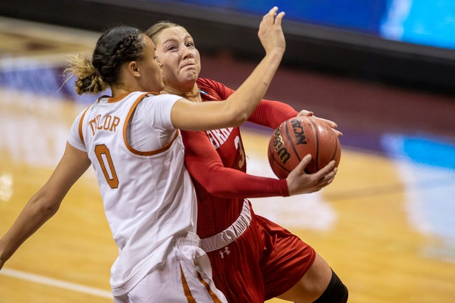 Bradley guard Gabi Haack (3) drives against Texas guard Celeste Taylor (0) during the second half of a college basketball game in the first round of the NCAA women's tournament at Strahan Arena in San Marcos, Texas, Monday, March 22, 2021. Texas won 81-62. (AP Photo/Ricardo B. Brazziell)