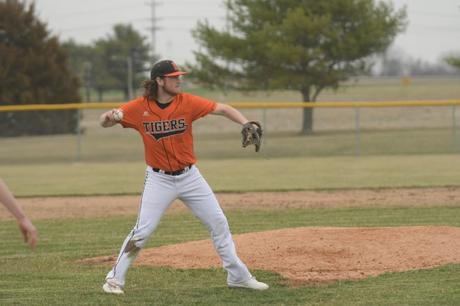 Kirksville pitcher Grant McHenry fields and throws to first for an out Monday against Jefferson City.