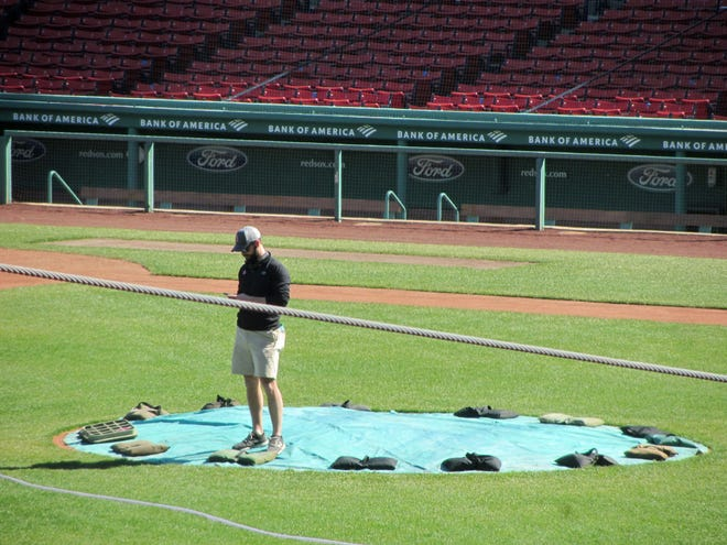 The grounds crew has been busy getting Fenway Park ready for the new season. Hopefully the Red Sox' pitchers won't turn the mound into a hill of horrors, as they did last year.