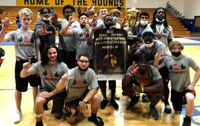Lakeland weightlifters celebrate after winning the Polk County Boys Weightlifting Championship on Friday at Auburndale High School.