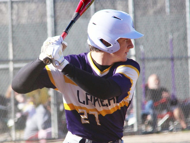 Camdenton sophomore Kam Durnin looks at a pitch in a game against Eldon on March 19 in Camdenton.