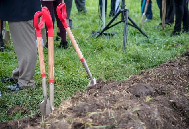 Shovels sit deep in a pile of dirt during a previous groundbreaking ceremony held in the lake area in 2018.