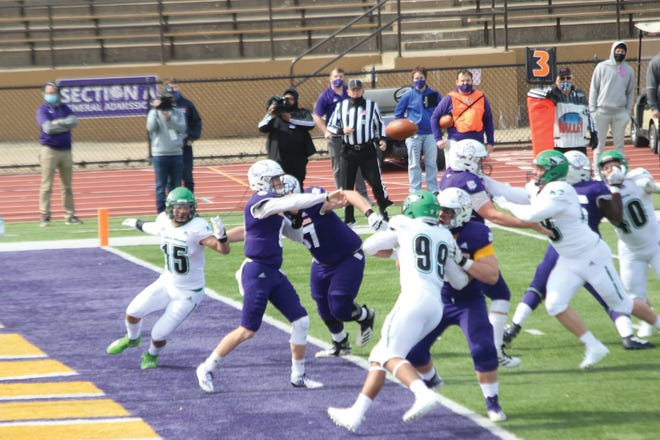 Western Illinois quarterback Connor Sampson drops back to pass during a game against North Dakota.
