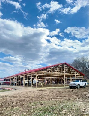 One year after the building burned down, the maintenance building that was once home to the Apple Harvest apple butter making process is now under roof.