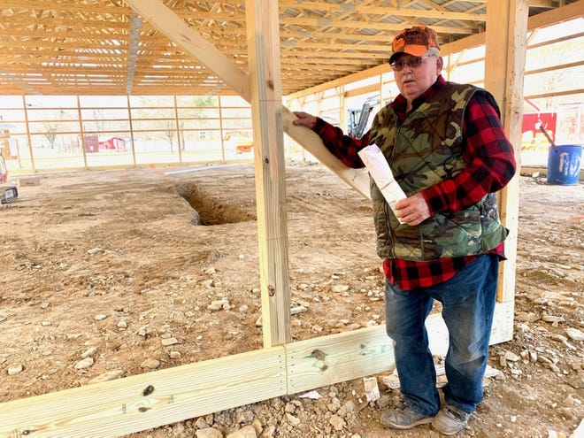 Jeff Pyle, Apple Harvest volunteer and long-time overseer of the apple butter making process, checks out the new maintenance building now under construction on the BUMFS Burlington campus.