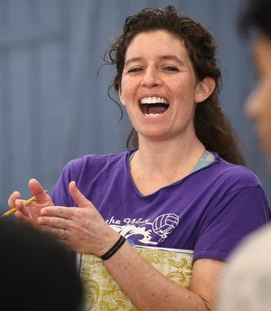 Framingham High girls volleyball coach Emily Viti talks to her players during tryouts at Framingham High School in 2017. So far this Fall II season, Viti is coaching her team via Zoom.