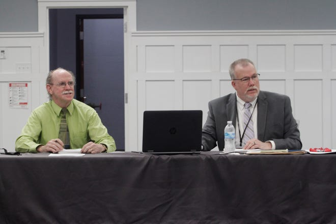 Moberly Area Community College Board of Trustees President Jim Cooksey, left, and MACC President Dr. Jeff Lashley listen to comments made during a Monday, Mach 22 trustees business meeting held at the college.