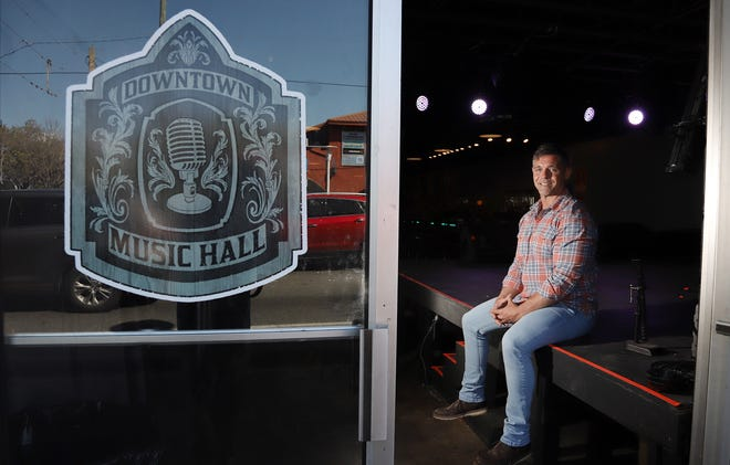 Gateway Church Pastor J Sansom sits onstage near the front door Downtown Music Hall in Fort Walton Beach. The church will hold Sunday Brunch Hour services there beginning on Easter Sunday.