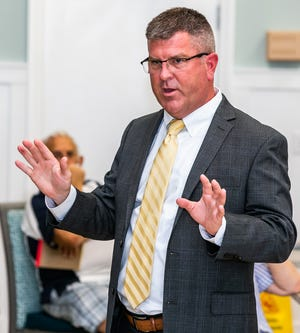 State Attorney Bill Gladson, shown at a community event last month, secured county funding to help his office work through the pandemic-caused case backlog.