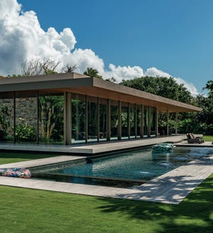 """A lap pool was designed by Keith Williams to make the award-winning, modern-style house seem like it was floating above it. The landscape is featured in the chapter titled """"Monochromatic"""" in Williams' new book, """"The Graphic Garden."""""""