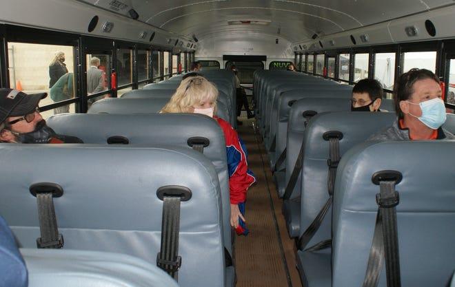 Passengers anticipate the maiden voyage of Pekin Public Schools District 108's electric school bus.