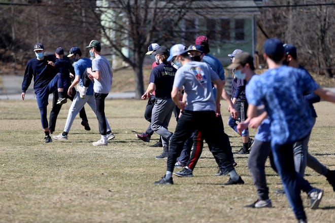 Members of the Traip Academy baseball team warm up prior to practice Tuesday afternoon at Memorial Field in Kittery, Maine.