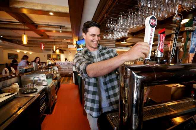 Damian Rosa, the great-great nephew of Ralph Rosa, pours the first beer at The Rosa Restaurant on Tuesday afternoon in Portsmouth.