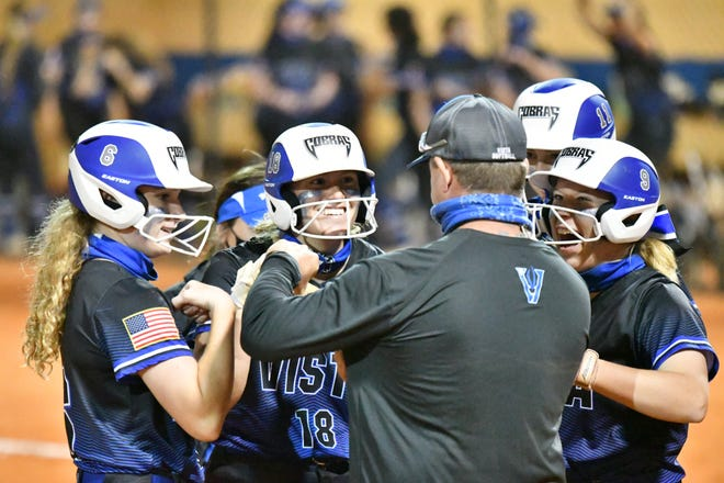 Park Vista head coach Joe DellaRocca, and players, from left to right, Danielle Dougherty, Kelsey Ganci, Bri Schanuel, and Rylee Kenthave a moment of celebration during a 10-1 regular-season win against Palm Beach Gardens earlier this month.