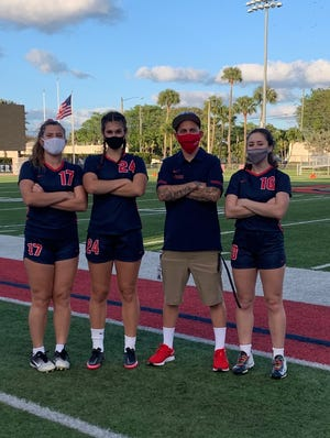 Oxbridge first-year coach Remington Young, second from right, has guided the ThunderWolves to two consecutive wins to start the season. Also pictured, from left to right: Kayla Brusie, Sophie Arlosoroff, Sydney Williams