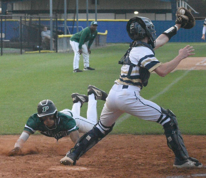 Conner Allen beats the throw to home for Plaquemine in action Monday at St. John.