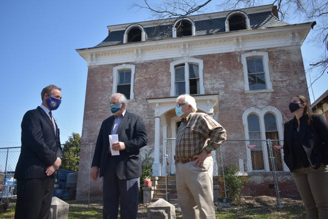 Sen. Joseph D. Morrissey stands in front of his previously blighted S. Market St. home that is undergoing renovations. The Historic Petersburg Foundation offers support for the project to restore a prominent home in the city.