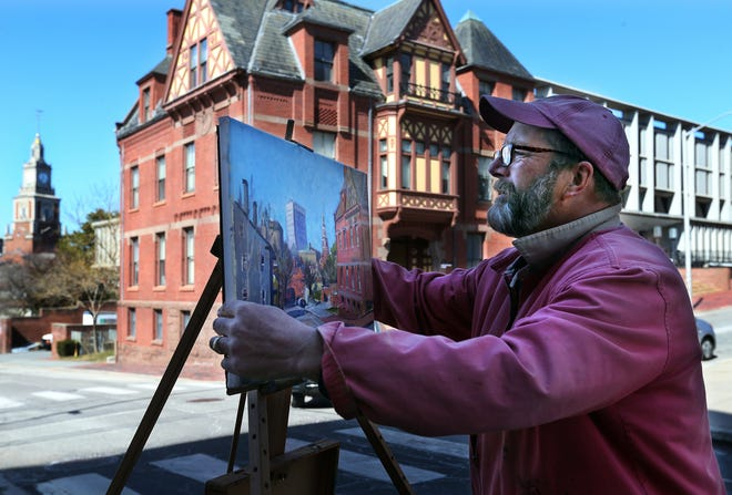 Providence Art Club member Harley Bartlett of Scituate paints a street scene along George Street near Brown University in Providence on Tuesday.