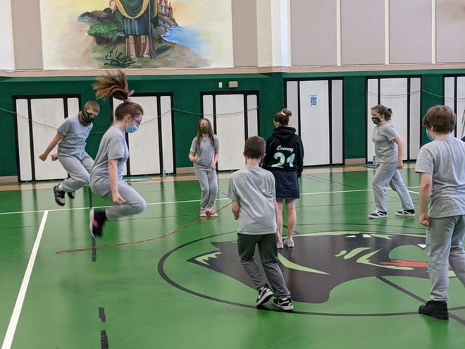 Students from Kent's St. Patrick School participate in physical activities.