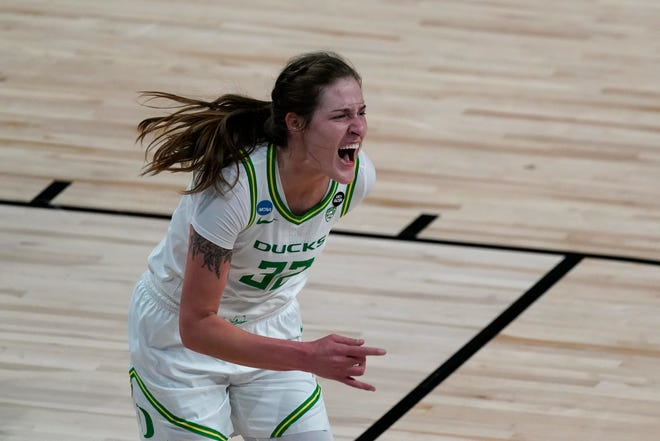 Oregon forward Sedona Prince celebrates after a basket during the first half of a college basketball game South Dakota in the first round of the women's NCAA tournament at the Alamodome in San Antonio, Monday, March 22, 2021.