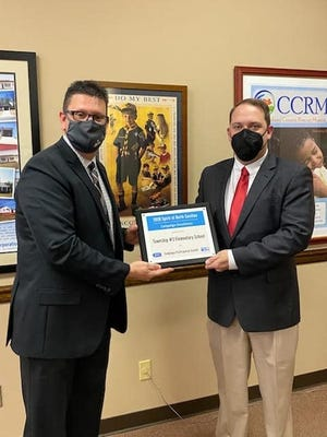 Cleveland County Schools Superintendent Stephen Fisher is shown with Dr. Dustin Bridges.