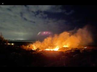 A fire burns near Access 7 on Siesta Key Beach