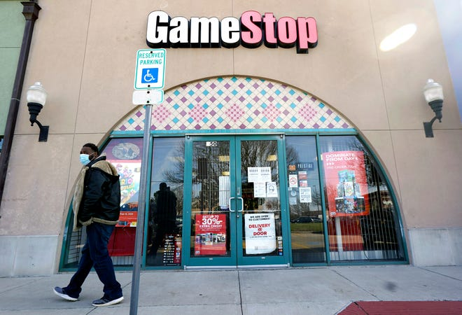 GameStop, whose stock price soared in January after a social media-fueled frenzy, said on Tuesday that its would suspend providing earnings guidance as it focuses on an effort to transform into a more online-focused retailer.