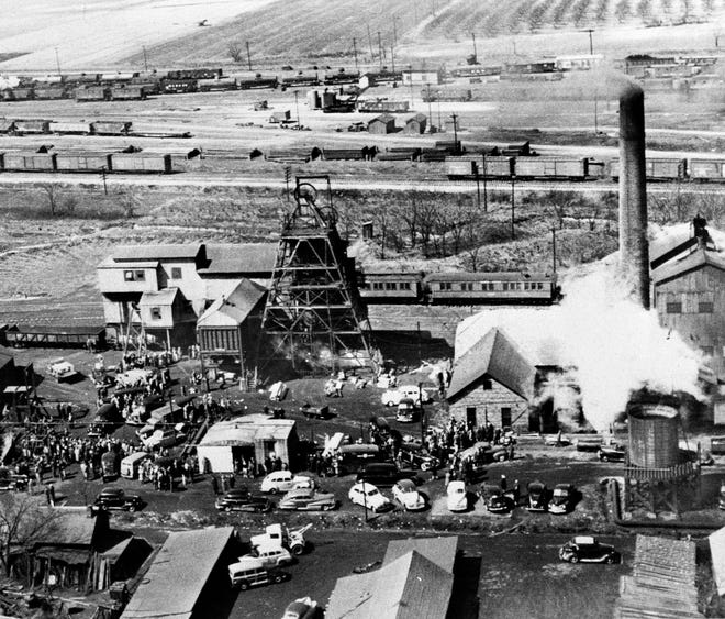 This is a March 26, 1947 aerial view of the Centralia Coal Co., mine No. 5 near Centralia, Illinois, with rescue workers and ambulances grouped around the tipple as efforts were pressed to save more than 100 workers trapped by an explosion the day before.