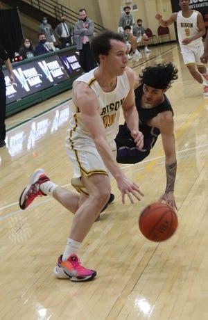 OBU's Brantly Thompson (10) drives the basketball toward the hoop during the 2020-2021 season.