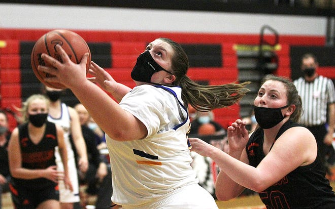 Centreville's Hannah Hartong snags an entry pass while eyeing the basket before scoring two points on Monday evening.