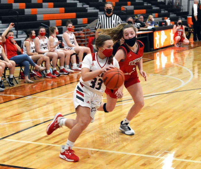 Charlee Balcom of Constantine pushes the ball on the baseline against Vicksburg on Monday evening.