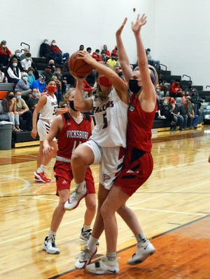 Leah Dumm heads up to score two points for Constantine on Monday evening.