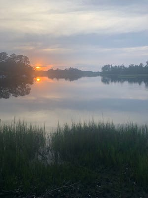 A beautiful sunset on Bradley Creek hides a water quality problem.