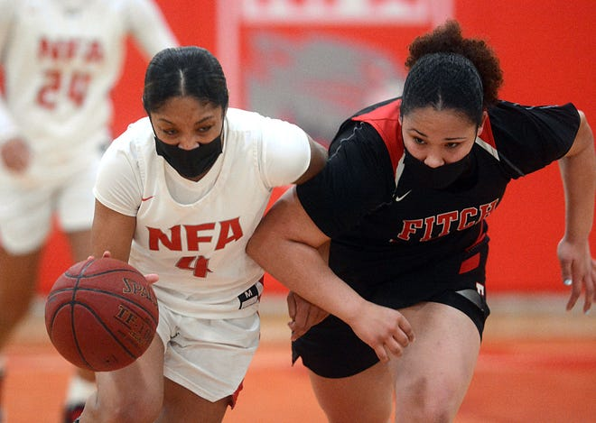 NFA's Jenissa Varela brings the ball up court under pressure from Fitch's Frankie Foster Monday during NFA's 57-46 win in Norwich.