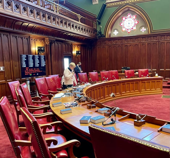 Sen. Cathy Osten stood alone due to COVID precautions, speaking on a bill Tuesday. She made no comments about her vote against the governor's former top legal aide.
