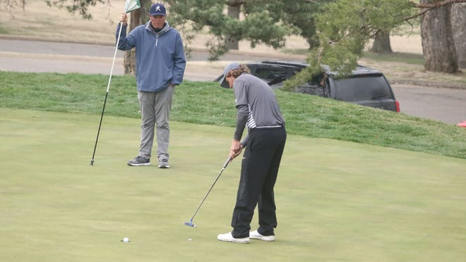 Washburn's Andrew Beckler sinks a putt on No. 9 during Monday's opening round of the Washburn Invitational at Topeka Country Club. Beckler set the amateur course record with a 7-under 64, taking a nine-shot lead into today's final round.