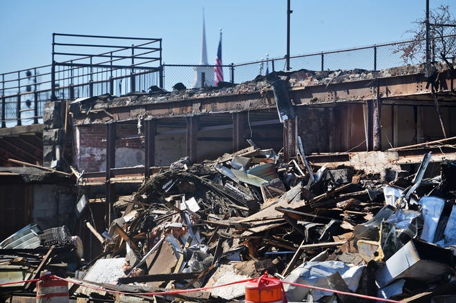 A large debris pile remains after an empty building in Washington Square was leveled Tuesday.
