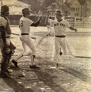 Marty Barrett is congratulated by Wade Boggs upon scoring the winning run in the 33-inning game at Pawtucket during the 1981 PawSox season.