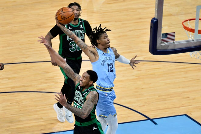 Memphis Grizzlies guard Ja Morant goes up for a dunk against Boston Celtics guard Jeff Teague in the second half of Monday's game.
