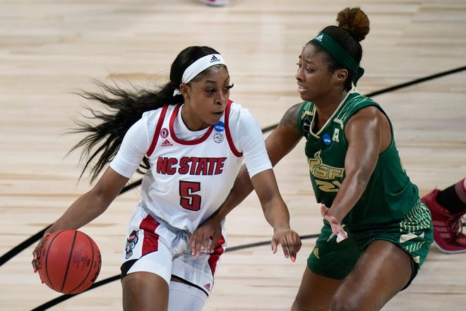 North Carolina State forward Jada Boyd (5) drives past South Florida center Shae Leverett (21) during the first half of a college basketball game in the second round of the women's NCAA tournament at the Alamodome in San Antonio, Tuesday, March 23, 2021. (AP Photo/Eric Gay)