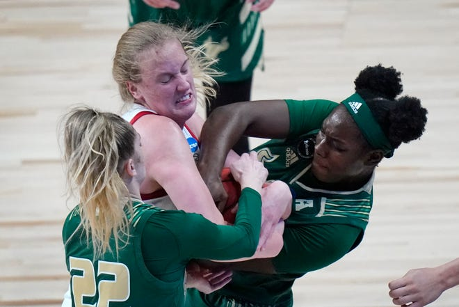 South Florida forward Kristyna Brabencova (22) and forward Bethy Mununga, right, fight for a loose ball with North Carolina State center Elissa Cunane during the first half of a college basketball game in the second round of the women's NCAA tournament at the Alamodome in San Antonio, Tuesday, March 23, 2021. (AP Photo/Eric Gay)